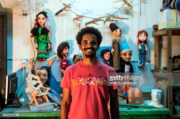 Egyptian artist and marionette maker Mohamed Fawzi Bakkar poses for a picture at his workshop in Cairo on April 22 2018