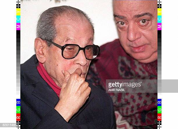 Egyptian author Naguib Mahfouz listens to Egyptian playwright Ali Salem during their daily literary meeting in Cairo 10 December Mahfouz a Nobel...