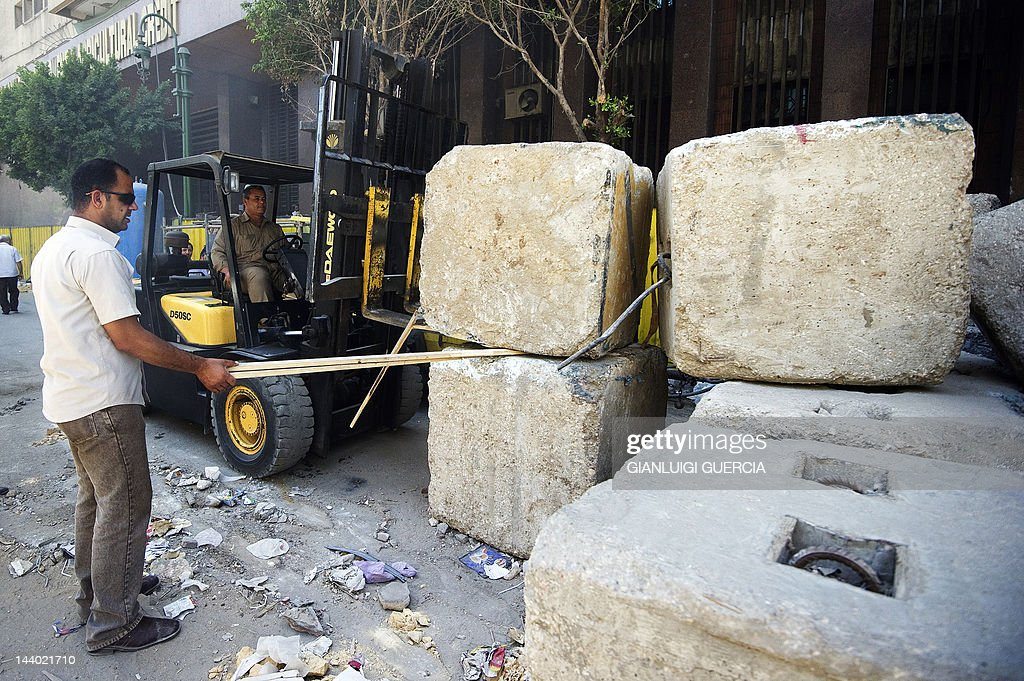 Egyptian authorities remove a wall of concrete blocks a