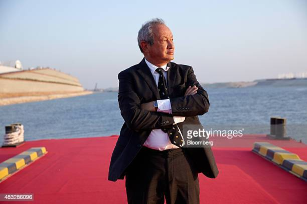 Egyptian billionaire Naguib Sawiris poses for a photograph on a floating pontoon in front of the New Suez Canal operated by the Suez Canal Authority...