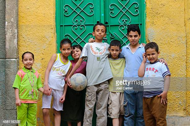 arab children with soccer ball - north africa stock pictures, royalty-free photos & images