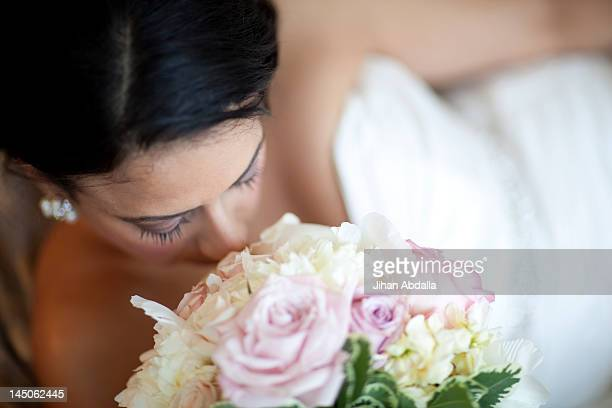 Egyptian bride smelling bouquet