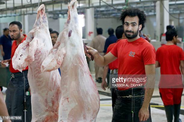 Egyptian butcher Mohammad Ibraheem aged 27 work at a slaughterhouse in Kuwait City on August 13 during the third day of Eid alAdha Mohammed is famous...