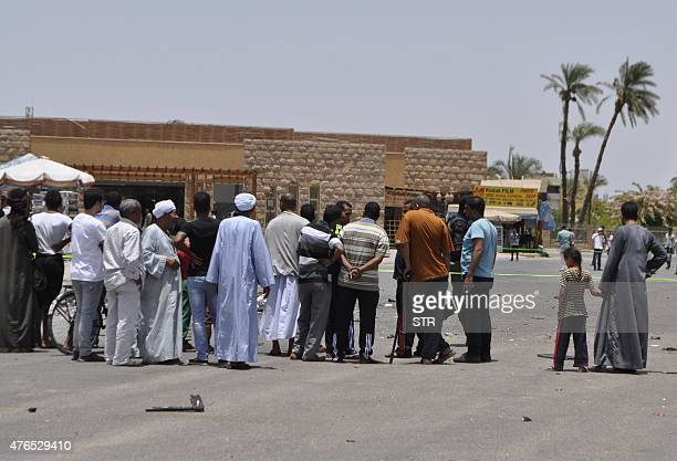 Egyptian bystanders look at the scene where assailants attempted to carry out a suicide bomb attack on June 10 in the Karnak temple in Luxor a town...