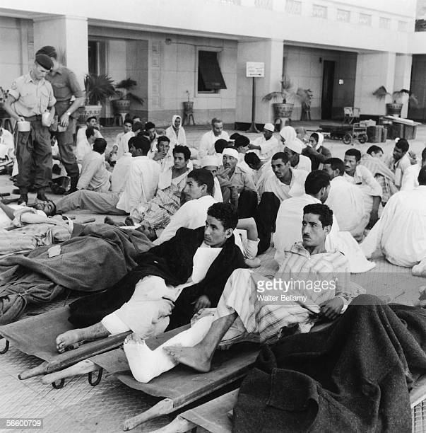Egyptian casualties lying on stretchers at a Red Cross hospital during the Suez Crisis 15th November 1956