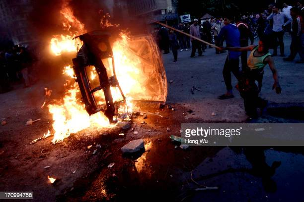 Egyptian children strike a burning police vehicle during a demonstration in Tahrir Square on March 03 2013 in Cairo Egypt After two years since the...