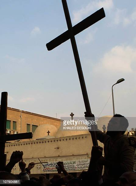 Egyptian Christian coptics protest outside the alAbasseya Cathedral in Cairo as Egyptian Grand Imam of AlAzhar Ahmed alTayeb Egyptian Mufti Ali Gomaa...
