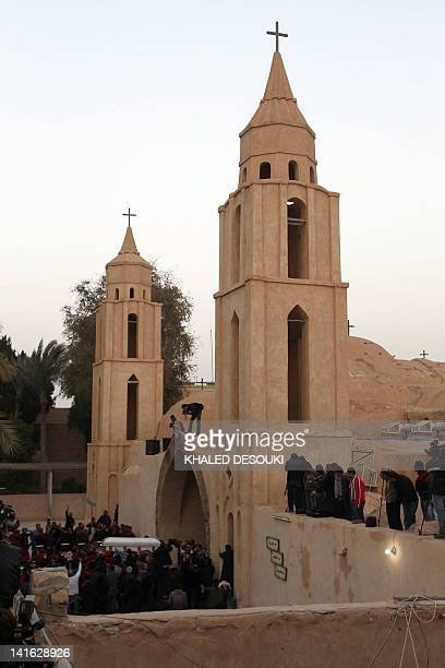 Egyptian Christian Copts carry the coffin of Coptic Pope Shenuda III the spiritual leader of the Middle East's largest Christian minority to his...