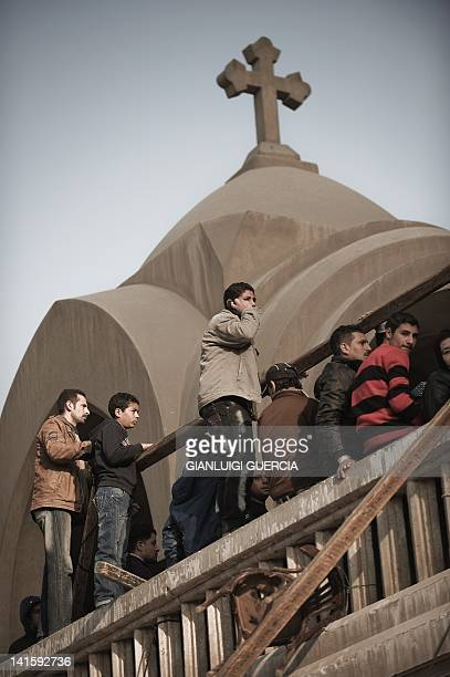 Egyptian Christian Copts wait in a queue to enter Saint Mark's Coptic Cathedral in Cairo's alAbbassiya district on March 19 2012 where tens of...