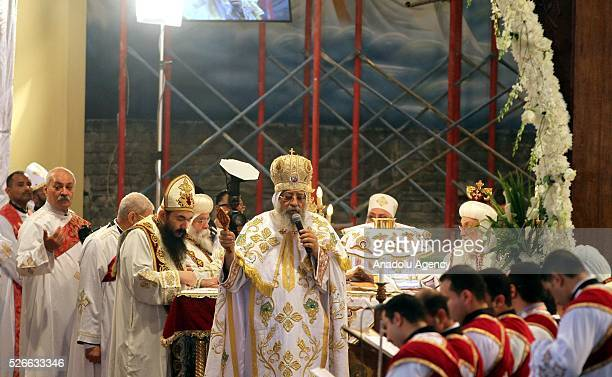 Egyptian Christians attend the Holy Saturday mass led by the Pope Tawadros II of Alexandria at the Saint Mark Cathedral in the Abbassia neighborhood...