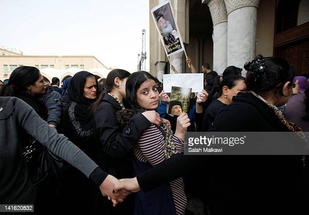 Egyptian Christians mourn during the funeral of Pope Shenouda III the head of Egypt's Coptic Orthodox Church at the Abassiya Cathedral at the funeral...