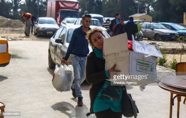 Egyptian Christians who took shelter at Saint Anthony church due to violent events in the Sinai Peninsula carry their belongings in Zaafarana Egypt...