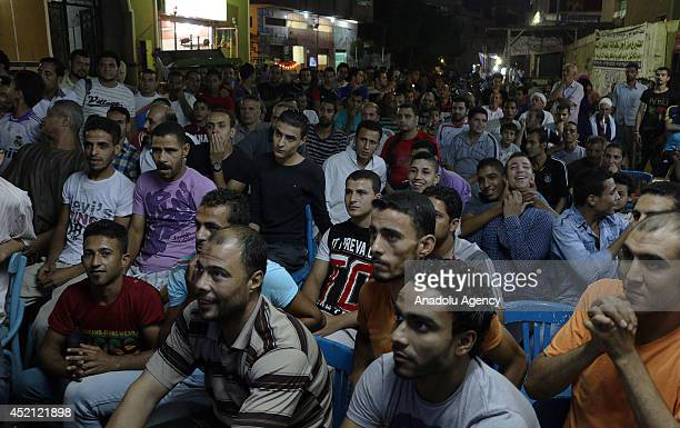 Egyptian citizens watch a live broadcast of World Cup final soccer match between Germany and Argentina in local cafe in Cairo Egypt on July 13 2014