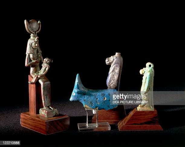 Egyptian civilization Late Period Amulets of deities Hathor and Taweret and statuette of Isis nursing infant Horus