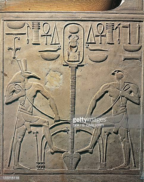Egyptian civilization Medium Kingdom Dynasty XII Pharaoh Sesostris I statue details from the throne depicting Horus and Seth with the symbol of unity...