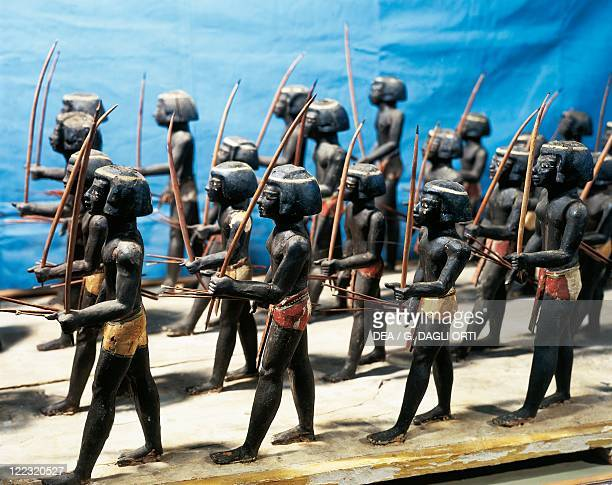 Egyptian civilization Middle Kingdom Wooden model of Nubian regiment made up of soldiers armed with bows and arrows From Asyut Egypt