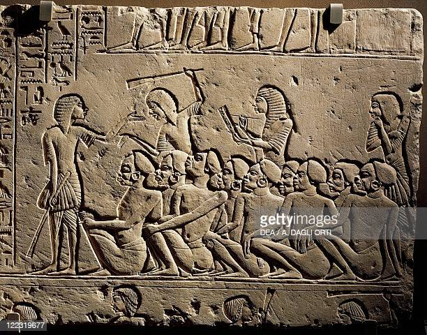 Egyptian civilization New Kingdom Dynasty XVIII 13321323 bC A group of Negroid prisoners surrounded by guards armed with clubs while a scribe draws...