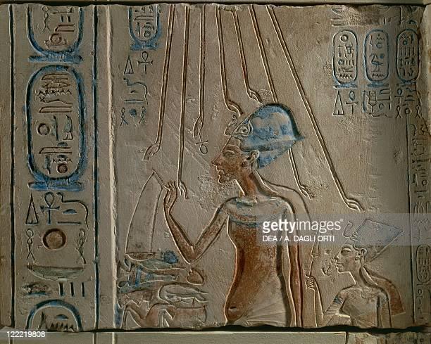 Egyptian civilization New Kingdom Dynasty XVIII Akhenaten and Nefertiti worshipping the solar disc From Tall alAmarnah