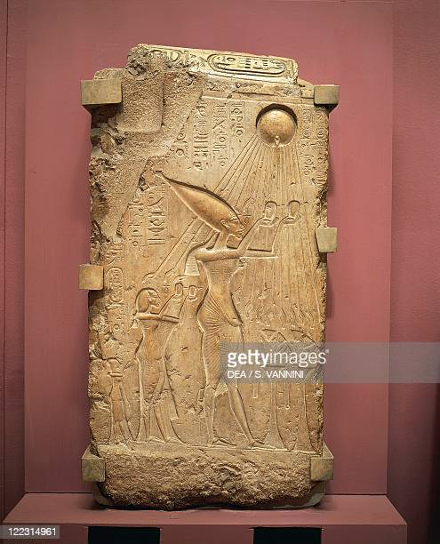 Egyptian civilization New Kingdom Dynasty XVIII Kingdom of Akhenaton Painted limestone slab with relief depicting Akhenaton Nefertiti and daughters...