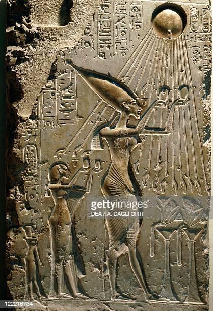 Egyptian civilization New Kingdom Dynasty XVIII Limestone relief depicting Akhenaton adoring the sun From Tall alAmarnah