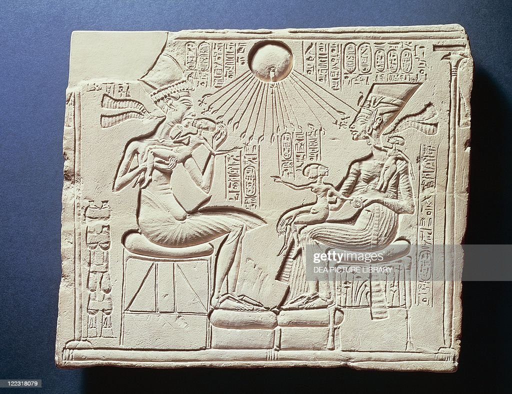 Relief depicting King Amenhotep IV (Akhenaten), his wife Nefertiti and their children under rays of sun god Aton, relief from Tall al-Amarnah, New Kingdom, Dynasty XVIII : News Photo