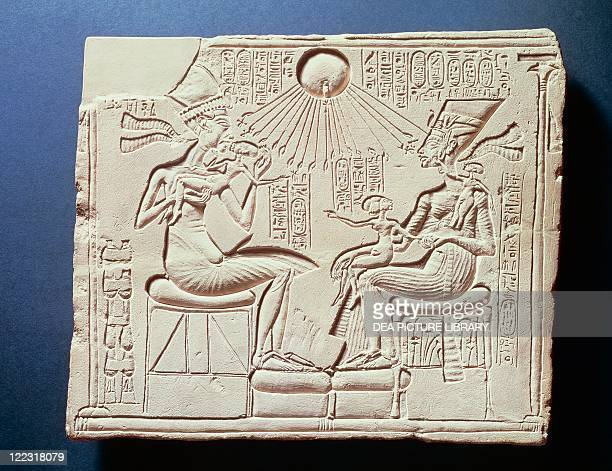 Egyptian civilization New Kingdom Dynasty XVIII Relief depicting King Amenhotep IV his wife Nefertiti and their children under the rays of the sun...