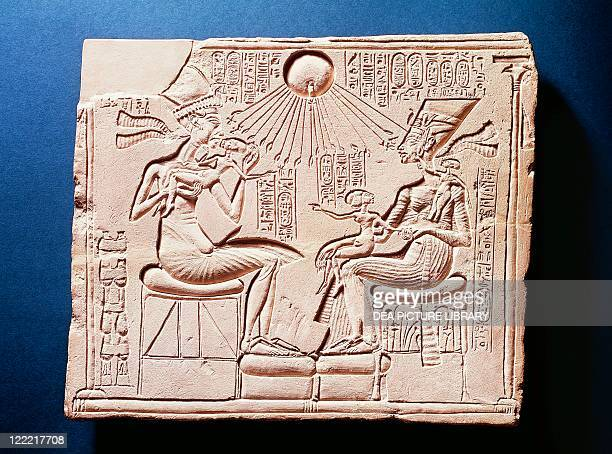 Egyptian civilization New Kingdom Dynasty XVIII Relief portraying King Amenhotep IV with his wife Nefertiti and their children under the rays of Aten...
