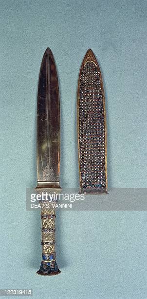 Egyptian civilization New Kingdom Dynasty XVIII Treasure of Tutankhamen Dagger of the king made of gold iron semiprecious stones and vitreous pastes...