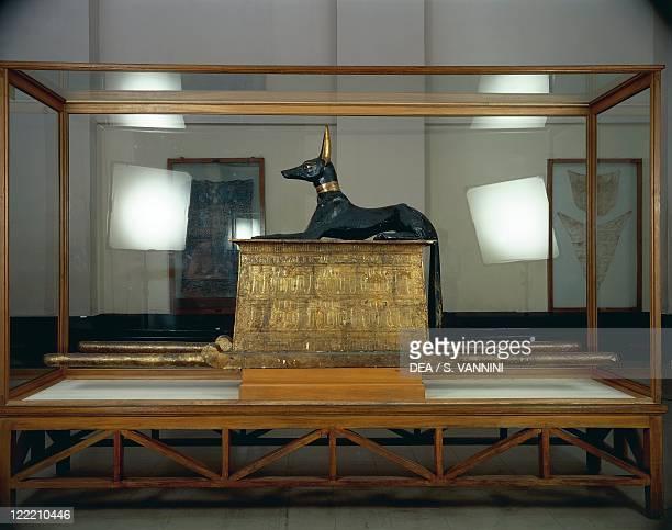 Egyptian civilization New Kingdom Dynasty XVIII Treasure of Tutankhamen Wooden statue of jackal god Anubis upon a gilded chest