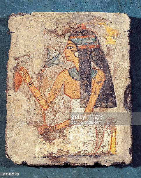 Egyptian civilization New Kingdom Fragment of painting on lemon wood depicting a woman at her toilet putting on some scent