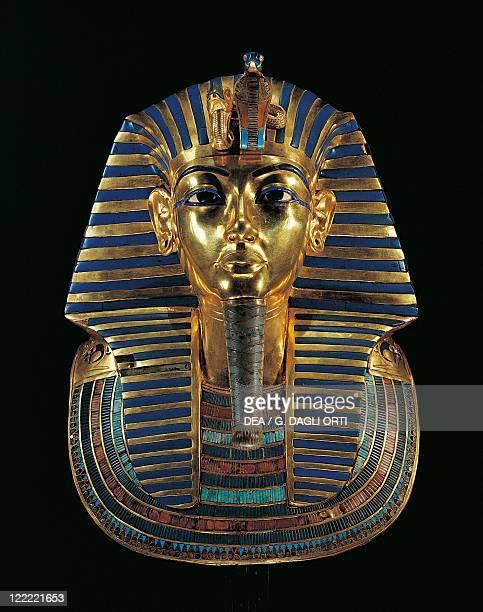 Egyptian civilization, Old Kingdom, Dynasty XVIII. Golden funerary mask of Tutankhamen inlaid with lapis lazuli, obsidian and turquoise.