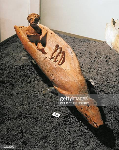 Egyptian civilization Predynastic Period Naqada II circa 3300 bC Crocodileshaped terracotta model of a boat with a male figure and three small...