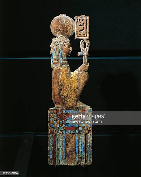 Egyptian civilization Ptolemaic period Gilded and glass inlaid decoration depicting the goddess Maat from a piece of furniture