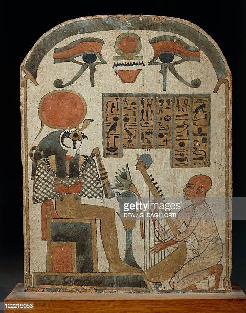 Egyptian civilization Third Intermediate Period Dynasty XXI Painted wood stele depicting Amon musician playing harp before god RaHarakhty