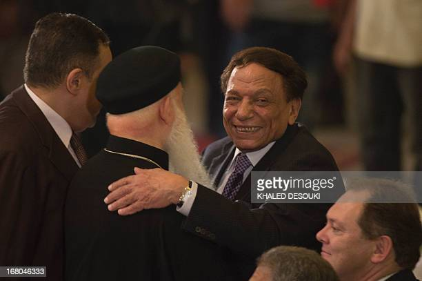Egyptian comedian Adel Imam attends the Easter mass led by Coptic Pope Tawadros II at the Saint Mark's Coptic Cathedral in Cairo's alAbbassiya...