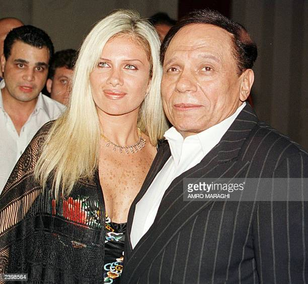 Egyptian comedian Adel Imam poses with his costar Lebanese Nicole Saba during the premier of 'The Danish Experience' at the Metro cinema in Cairo 06...
