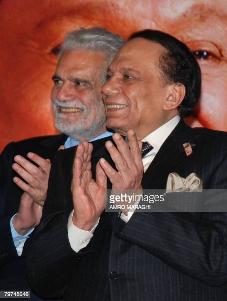 Egyptian comedian Adel Imam stands next to veteran actor Omar alSharif as they applaud following a press conference in Cairo late February 13 2008...