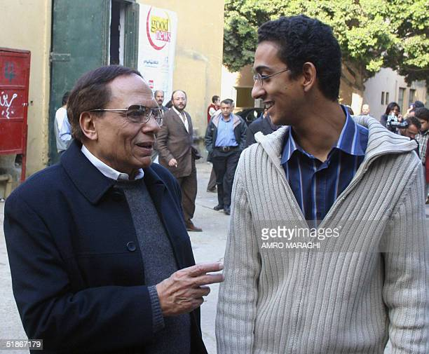 Egyptian comedian Adel Imam talks with director Marwan Hamed during the first day shooting of their new film Amaret Yaacoubian 16 December 2004 in...