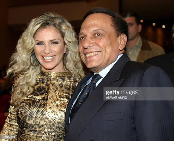 Egyptian comedian and film star Adel Imam and Lebanese actress Nicole Saba pose for photographers during the premier of their new film 'The Danish...