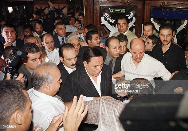 Egyptian comedian and film star Adel Imam arrives 05 August 2003 at the premier of his new comedy The Danish Experience in Cairo AFP PHOTO/Anwar AMRO
