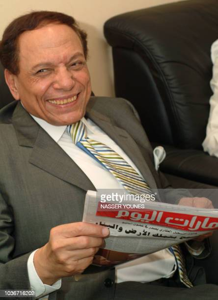 Egyptian comedy Star Adel Imam reads a copy of the United Arab Emriate's daily newspaper Emirates Today in Dubai 13 December 2005 Imam is attending...