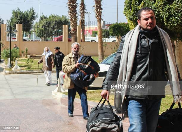 Egyptian Coptic Christians arrive with their belongings to take refuge at the Evangelical Church in the Suez Canal city of Ismailiya on February 25...