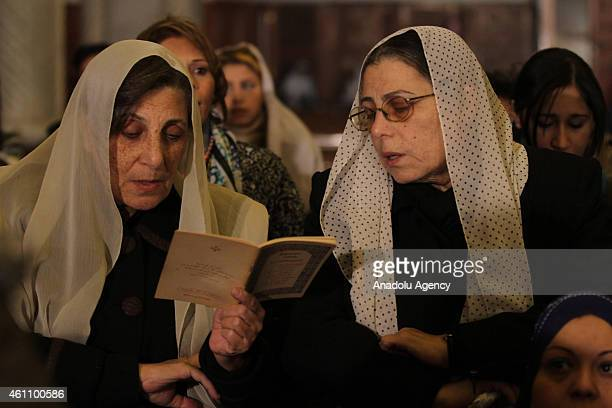 Egyptian Coptic Christians attend a Christmas Eve mass led by Egyptian Coptic Pope Tawadros II at the St Mark's Coptic Orthodox Cathedral in the...