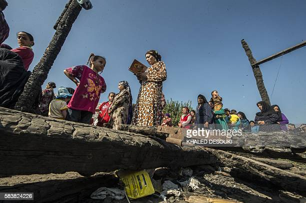 Egyptian Coptic Christians attend a mass on July 24 in the rubble of a makeshift chapel that was torched a few months ago during clashes in the...