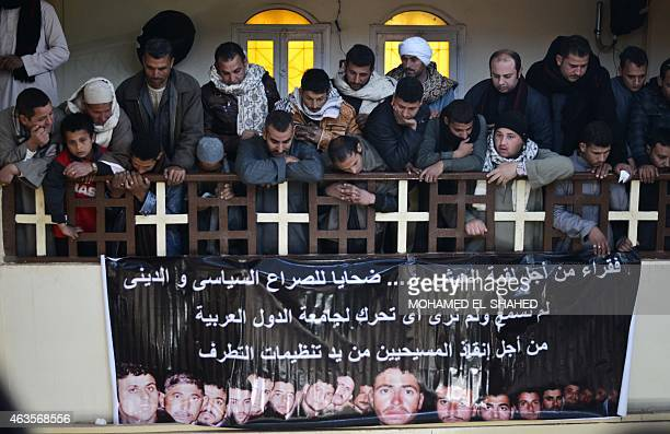 Egyptian Coptic Christians attend a memorial ceremony for relatives purportedly murdered by Islamic State group militants in Libya on February 16 in...