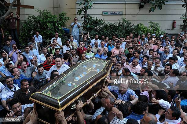 Egyptian Coptic Christians carry the coffin of a victim of sectarian clashes during a funeral in Cairo on May 8 2011 as Egypt's military rulers...