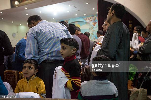 Egyptian Coptic Christians gather for a Christmas Eve mass in a chapel at the St Saman Monastery in the Manshiet Nasser district on January 6 2014 in...