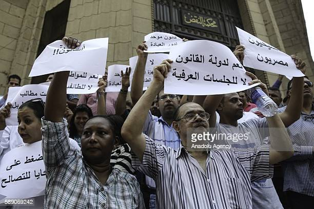 Egyptian Coptic Christians hold banners reading 'Christians are Egyptian' 'Where is the State of Law' and 'No to Sectarianism' to protest the...