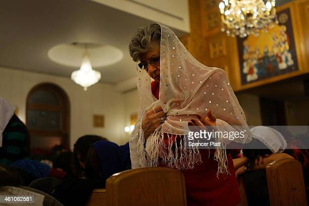 Egyptian Coptic Christians pray as they celebrate Christmas Nativity Liturgy the start of Christmas at the Coptic Orthodox Church of St George on...