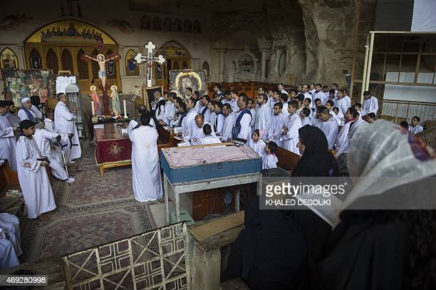 Egyptian Coptic Christians pray during a religious ceremony for the Orthodox Good Friday at the Samaan elKharaz monastery in Cairo's Mount Muqattam...